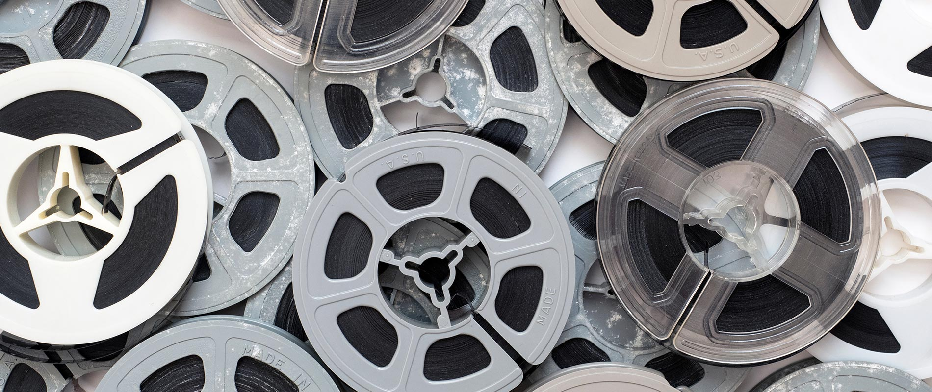 pile of 8mm film reels